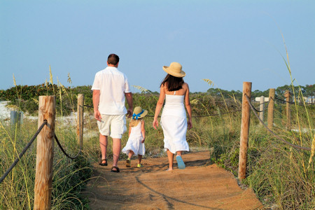 family walking to the ocean