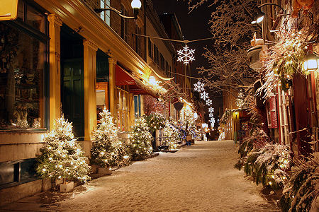 quebec street in snow decorated for christmas