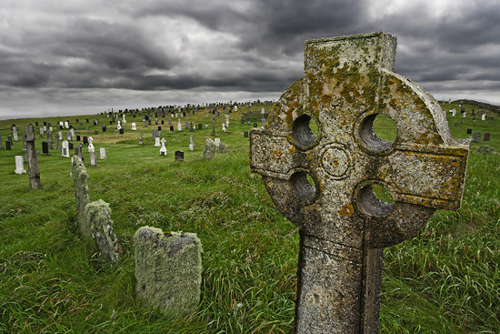 Old Celtic graveyard with gravestones from 1600's in rural Scotland.