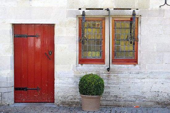Wooden red door on street in Belgium.