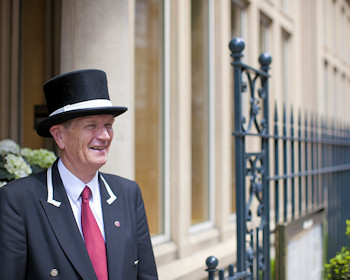 Doorman welcomes guests to The Capital Hotel.
