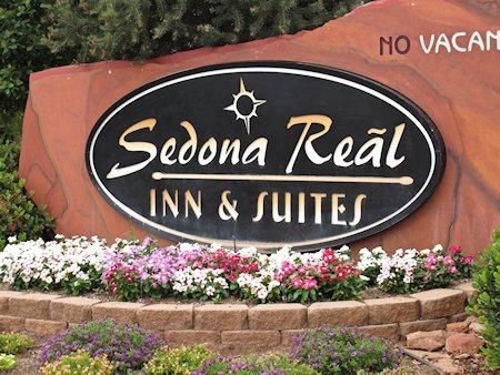 Sign for the Sedona Reãl Inn & Suites in Sedona, Arizona.