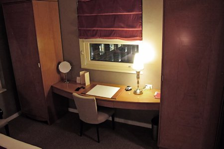 Wide desk in the suites bedroom. Closets on either side.