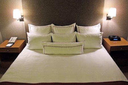 King Bed in suites bedroom.
