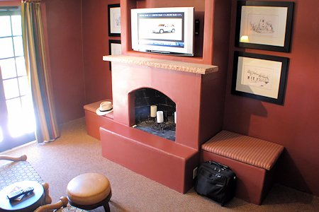 Decorative fake fireplace in the room.