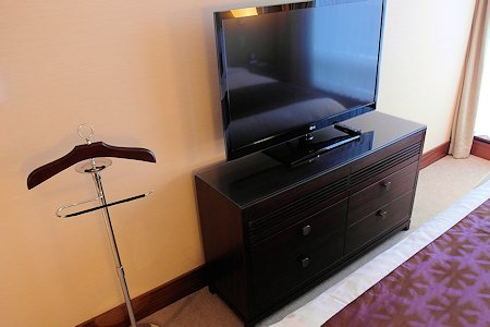 Bedroom includes HDTV and butlers stand
