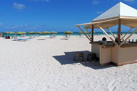Vendors on beach provide services.  South Beach, Florida