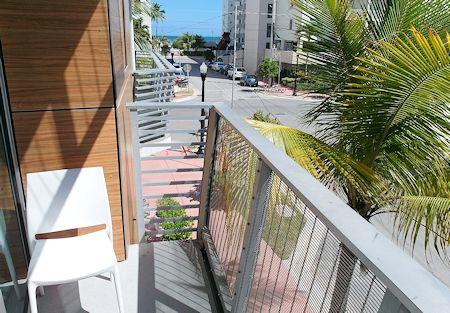 Balcony and view of beach. Sense Beach House, South Beach, Miami Florida