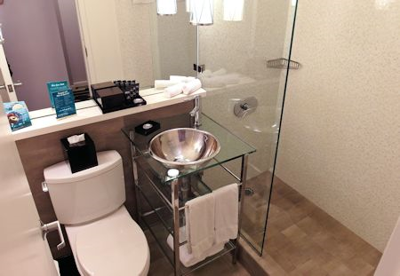 Nicely renovated bathroom. The Surfcomber Hotel Miami | South Beach, Florida