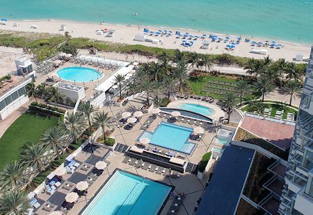 View from balcony of the four pools at the Eden Roc Hotel in Miami Beach, Florida