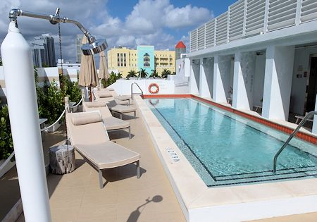 Small shallow pool with lounge chairs on the roof of Sense Beach House, South Beach, Miami Florida