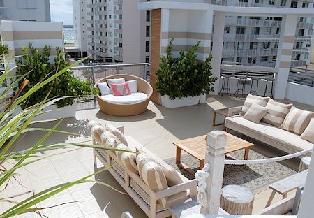 Rooftop seating area is great for relaxing in the sun at Sense Beach House, South Beach, Miami Florida