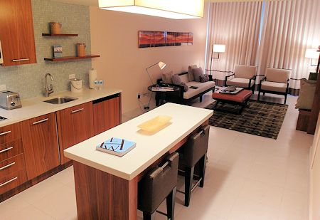 Kitchenette and living area of this One Bedroom King Suite at Canyon Ranch Hotel & Spa, Miami Beach, Florida