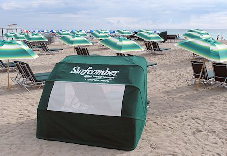 Chairs and umbrellas are available from the beach staff of The Surfcomber Hotel Miami | South Beach, Florida