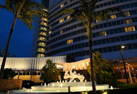 Exterior front view after dark of the Fontainebleau Hotel, Miami Beach Florida