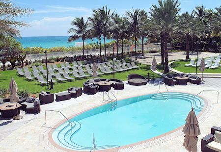One of the pools with lounge chairs at the Eden Roc Hotel in Miami Beach, Florida