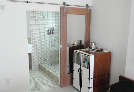 Minibar and entrance to the bath at The James Royal Palm Hotel, South Beach, Miami Florida