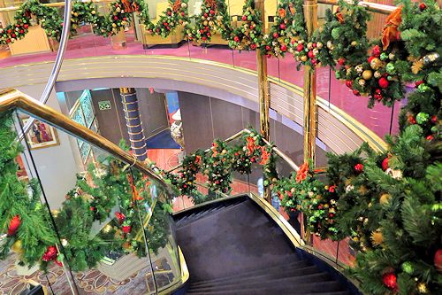 Stairway leading to the Atrium of Westerdam decorated for Christmas.