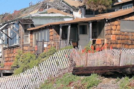 Old historic cottages awaiting restoration along Crystal Cove State Beach.
